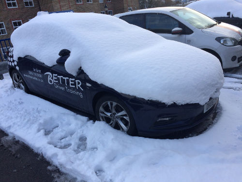 Better Driver Training Car under snow.